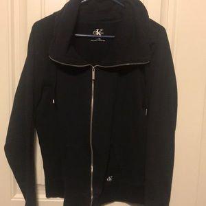 Black zip front fleece jacket.